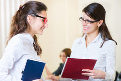 Two young girls at business meeting Stock Photo