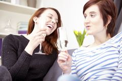 Two young girls with champagne Stock Photo