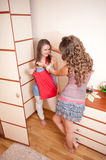 Two young girls choosing dress Royalty Free Stock Photography