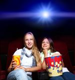 Two young girls in cinema Royalty Free Stock Images