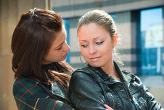 Two young girls in a city Royalty Free Stock Images