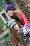 Two young girls with colorful winter clothes Royalty Free Stock Image