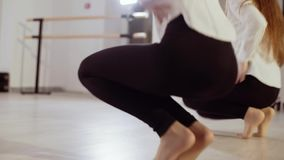 Two young girls are dancing in the dance studio. Evening dance rehearsal. Two young girls are dancing in the dance studio. Evening dance rehearsal stock video footage