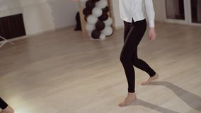 Two young girls are dancing in the dance studio. Evening dance rehearsal. Two young girls are dancing in the dance studio. Evening dance rehearsal stock video