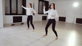Two young girls are dancing in the dance studio. Evening dance rehearsal. HD stock footage