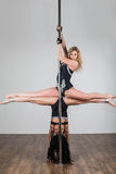 Two young girls doing difficult acrobatic tricks Royalty Free Stock Images