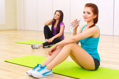 Two young girls doing gymnastic exercises Royalty Free Stock Image
