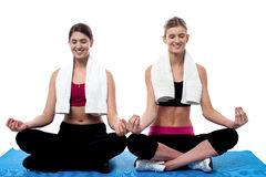 Two young girls doing yoga at gym Stock Photo