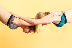 Two young girls doing yoga royalty free stock photography