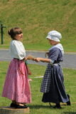 Two young girls dressed in period clothing during reenactment of French and Indian War, Fort Ontario, 2016 Royalty Free Stock Photo