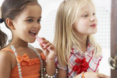 Two Young Girls Dressing Up And Putting On Make Up Together Royalty Free Stock Image