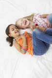 Two Young Girls Dressing Up Together In Bedroom Royalty Free Stock Photos