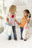 Two Young Girls Dressing Up Together In Bedroom Stock Photography