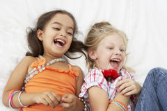Two Young Girls Dressing Up Together In Bedroom Royalty Free Stock Image