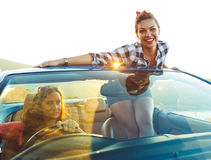 Two young girls driving a cabriolet. Two young happy girls driving a cabriolet Stock Photo