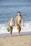 Two Young Girls Enjoying Beach Holiday Stock Photos