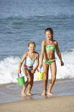 Two Young Girls Enjoying Beach Holiday Stock Photo