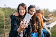 Group of four young women outdoors stock images