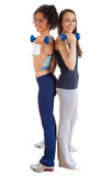 Two young girls exercising with weights Stock Photos