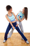 Two young girls fitness exercising with weights Stock Photo