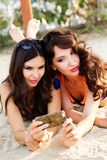 Two young girls friends together at the beach Stock Photography
