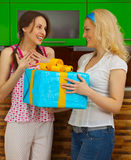 Two young girls with a gift Royalty Free Stock Images