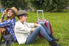 Two young girls girlfriends are traveling together. Nature. Royalty Free Stock Photography