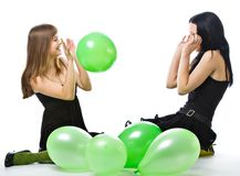 Two young girls with green ballons Royalty Free Stock Images