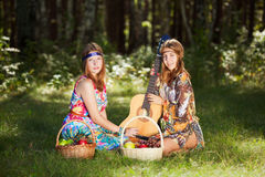 Two young girls with guitar outdoor Royalty Free Stock Photography