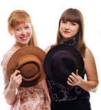 Two young girls with  hats, vintage style Royalty Free Stock Image