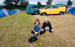 Two young girls have rest on the music festival Stock Photos