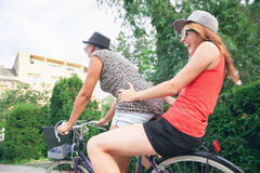 Two Young Girls Having On Bike Stock Photo