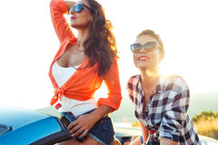 Two young girls having fun in the cabriolet outdoors Royalty Free Stock Photo