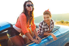 Two young girls having fun in the cabriolet outdoors. Two young happy girls having fun in the cabriolet outdoors Royalty Free Stock Photo