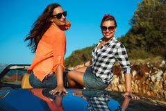 Two young girls having fun in the cabriolet outdoors. Two young happy girls having fun in the cabriolet outdoors Royalty Free Stock Image