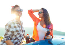 Two young girls having fun in the cabriolet outdoors Royalty Free Stock Image