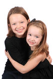 Two young girls hugging Royalty Free Stock Images