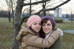 Two young girls. Hugging each other Royalty Free Stock Images