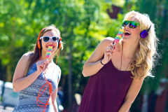Two young girls with ice cream Stock Photography