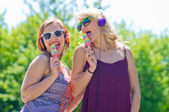 Two young girls with ice cream Stock Images