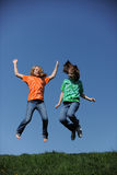 Two young Girls jumping Royalty Free Stock Images