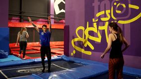 Two young girls jumping on a trampoline in an amusement Park. Trampoline park. 4K stock video