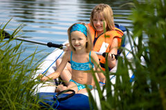 Two young girls at a lake Stock Photos
