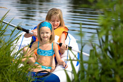 Two young girls at a lake Stock Image