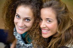 Two young girls laughing Stock Images
