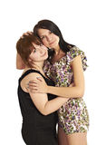 Two young girls leaned shoulder to shoulder with each other Royalty Free Stock Photography