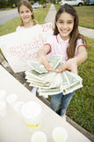 Two young girls at a lemonade stand royalty free stock photo
