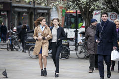 Two young girls with long hair are walking in the Spitalfield ma Stock Image