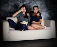 Two young girls looks TV Stock Images