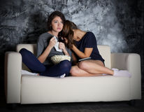 Two young girls looks TV Royalty Free Stock Photos